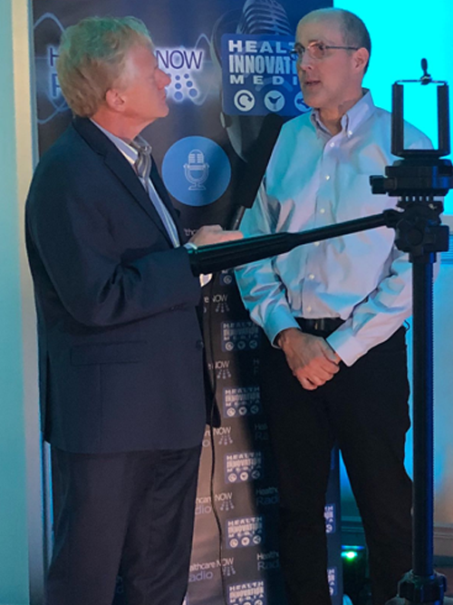 Andrew being interviewed at HLTH2019
